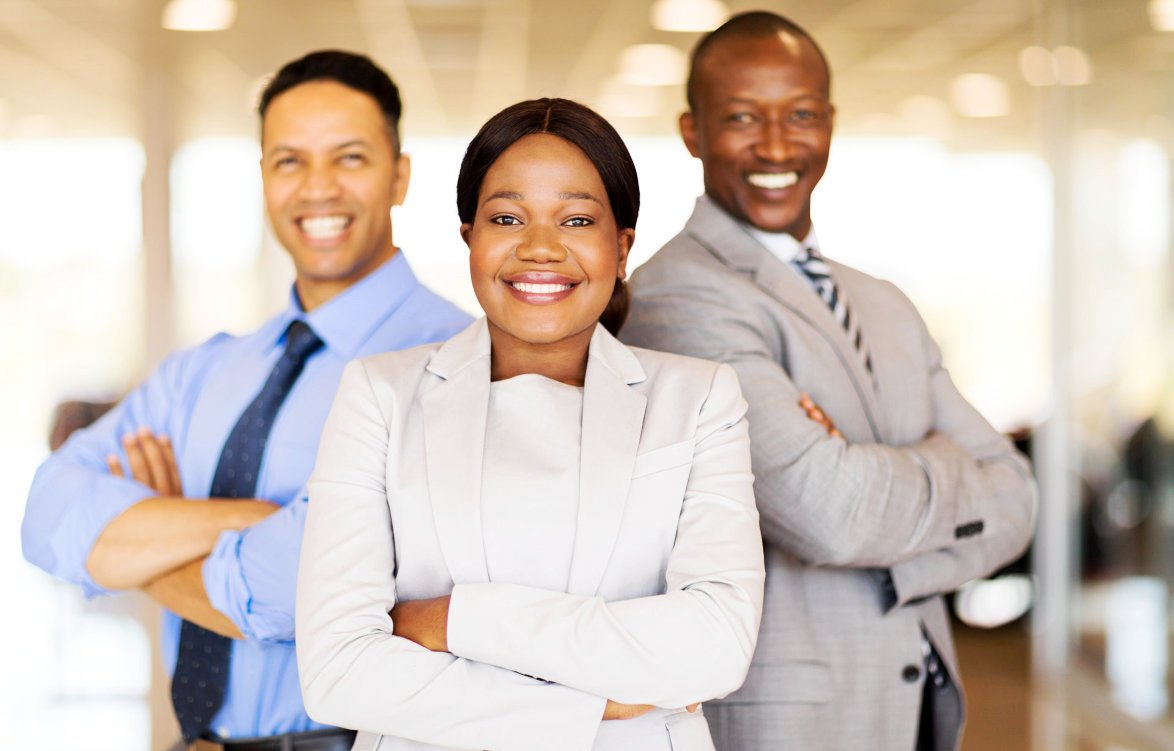 group of people smiling with proper attire
