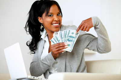 Portrait of a happy woman pointing plenty of cash money